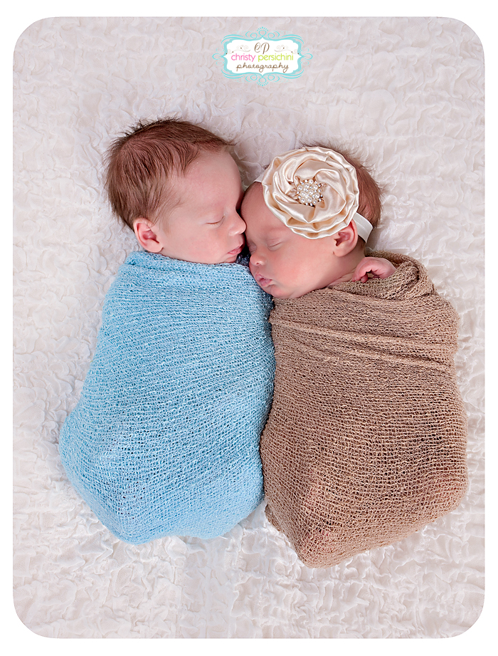 Newborn twins wrapped in colored wraps Christy Persichini Photography